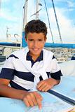boy teen sailor sitting on marina boat chart map