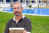 Senior man glasses relax on vacation garden pool