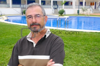Senior man glasses relax on vacation garden pool