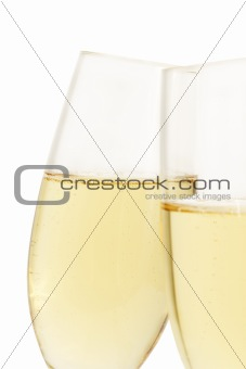 aslope glass of champagne behind other