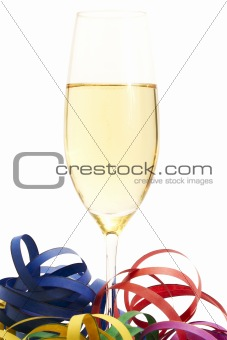 glass of champagne between streamer
