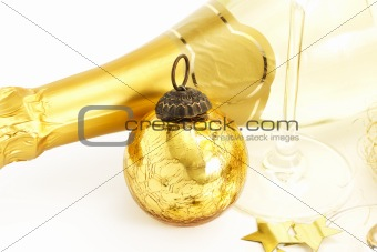 a golden vintage christmas ball with bottom of a champagne glass and a champagne bottle