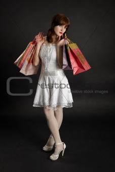 Beautiful young woman with purchases