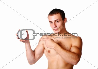 handsome guy shirtless with clock