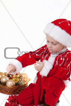 Boy in christmas clothes with toys