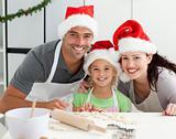 Happy family preparing Christmas cookies