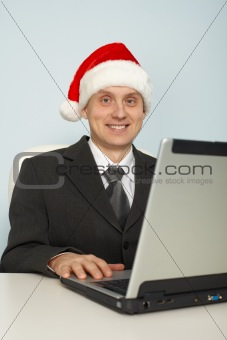Man in festive Christmas mood with laptop