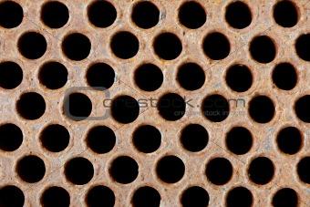 Rusty iron grate - element of industrial heat exchanger