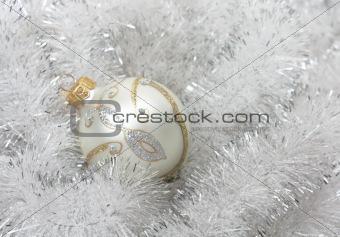 Christmas ball with a tinsel