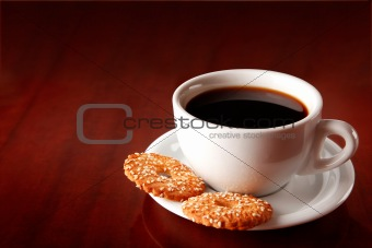 cup of coffee on saucer with cakes