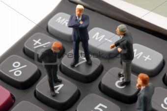 toy business man on calculator isolated