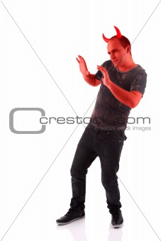 devil, with hands up as a sign of move away, defensive,  isolated on white background. Studio shot