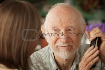Grumpy senior couple with telephone