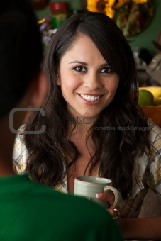 Beautiful Latina Woman with Cofee or Tea and Male Companion