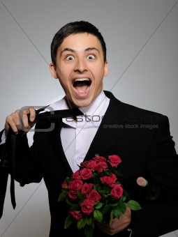 Happy romantic husband holding rose flower and vine bottle