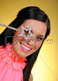 Beautiful woman with creative make-up and the star making a wish