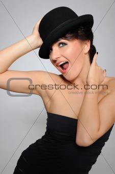 Beautiful pretty woman portrait in elegant dress and hat smiling