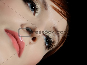 Beautiful macro shot of blue woman eyes with long lashes