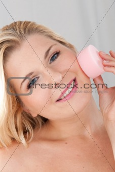 beautiful gir cleansing her face with sponge