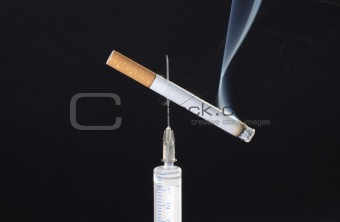 cigarette on needle