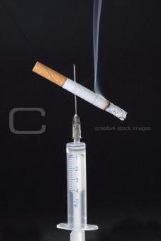 cigarette on needle