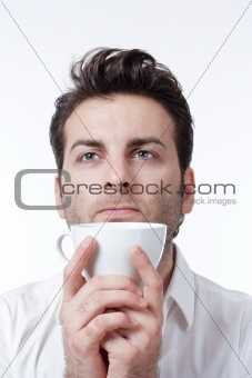 man in shirt holding cup of coffee looking up - isolated on white