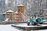 Empty children's playground covered in snow