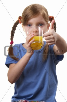 Young funny girl with a glass of juice