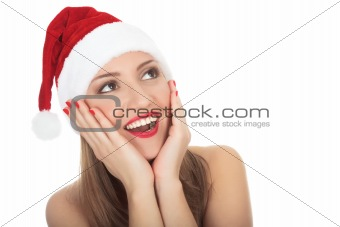 Surprised beautiful young woman wearing santa hat.
