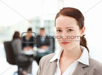 Charismatic businesswoman standing in the foreground while her t