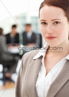 Attractive businesswoman during a meeting with her team