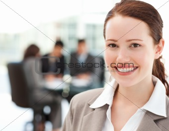 Cheerful businesswoman during a meeting with her team