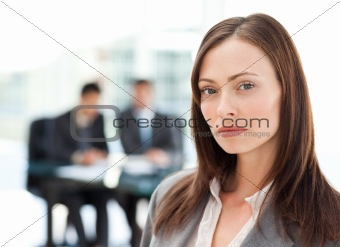 Beautiful businesswoman standing during a presentation with her