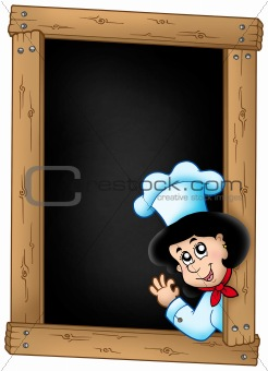 Blackboard with lurking woman chef