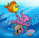 Cute octopus and orange fish