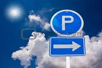 Car park sign over blue sky