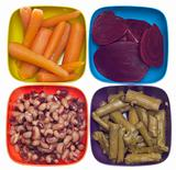 Variety of Canned Vegetables in Colorful Bowls