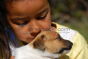 little girl and puppy