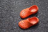 Orange croc style shoes