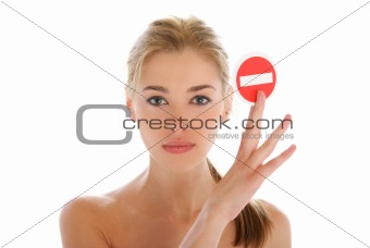 Beautiful woman with prohibiting sign