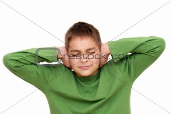 Teenage boy with arms on ears