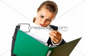 Serious modern business woman exploring documents