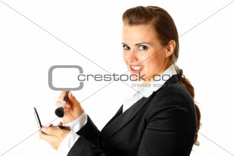 Smiling  modern business woman applying makeup
