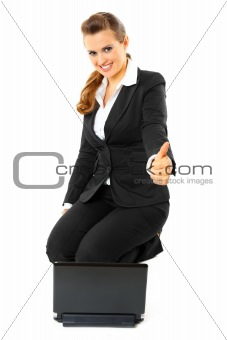 Sitting on floor with laptop smiling modern business woman showing thumbs up gesture