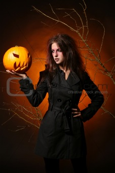 beautiful woman with a pumpkin in the hands