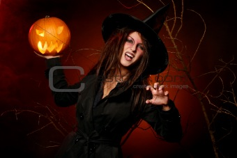 beautiful woman with a pumpkin