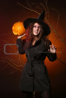 beautiful woman with a pumpkin