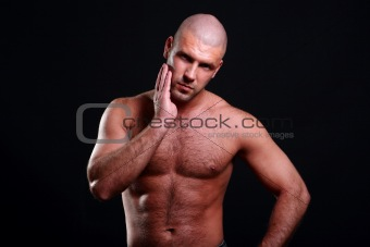 young and muscular man on black
