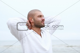 attractive and happy man on beach