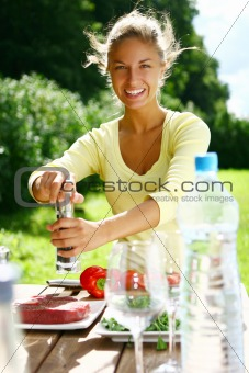 smiling and beautiful woman cooking